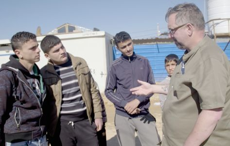 Mike visiting refugee camp